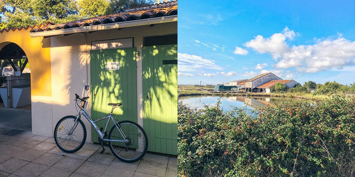 Ein Fahrrad an ein grünes Tor gelehnt, Häuser in der Landschaft der französischen Atlantikküste