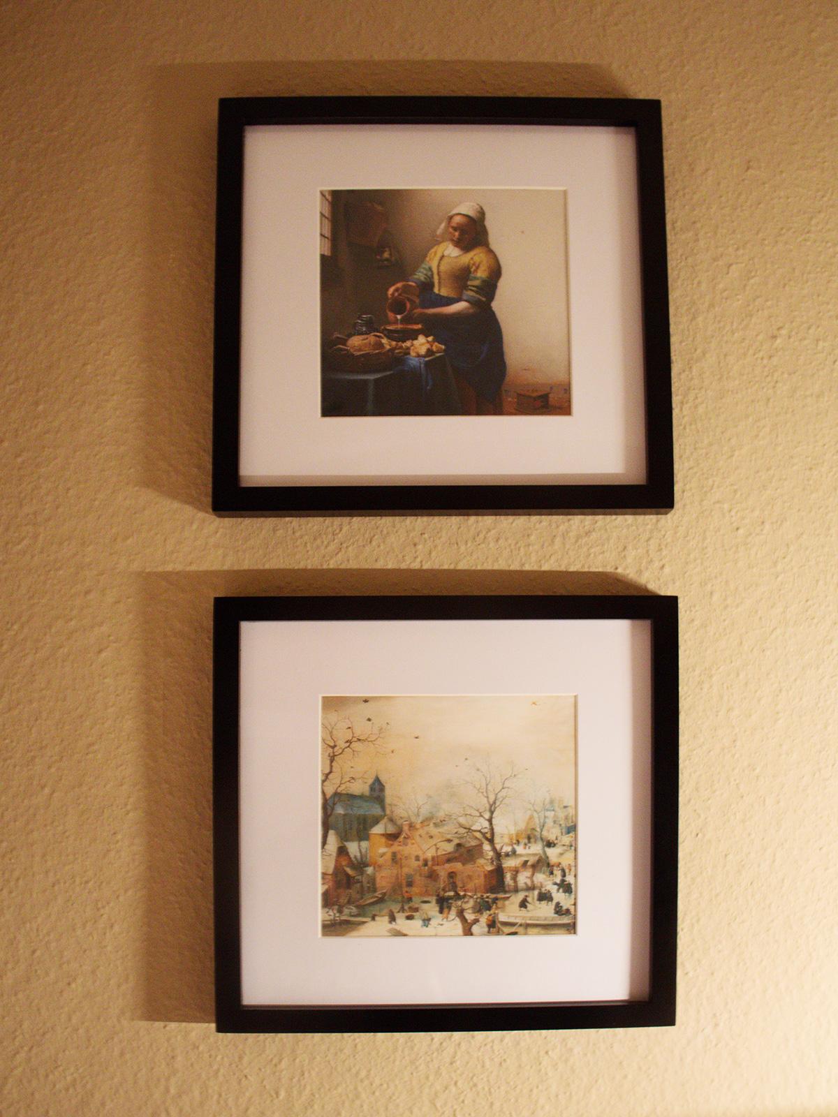 Vermeer und -prints in schwarzen Bilderrahmen